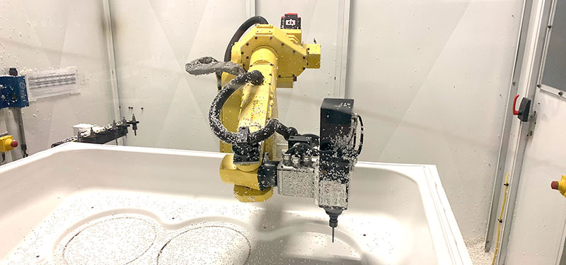 Robotic trimming of a plastic thermoformed part